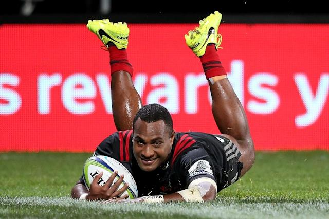 Manasa Mataele of the Canterbury Crusaders dives to score a try during a Super Rugby match in Christchurch, in April 2017 (AFP Photo/MARTIN HUNTER)