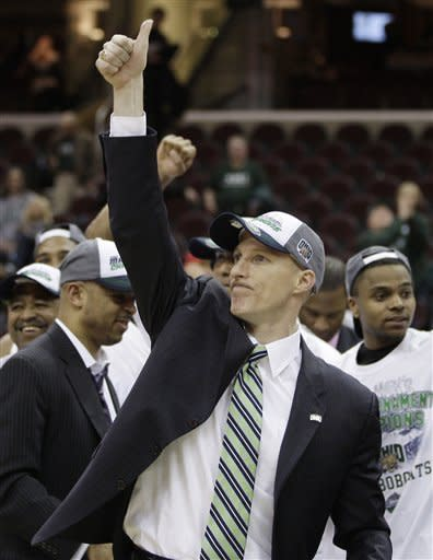 Ohio's head coach John Groce gives a thumbs-up after Ohio beat Akron 64-63 during an NCAA college basketball championship game in the Mid-American Conference men's tournament on Saturday, March 10, 2012, in Cleveland. (AP Photo/Tony Dejak)