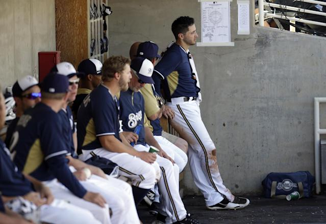 Milwaukee Brewers' Ryan Braun waits in the dugout during an exhibition spring training baseball game against the Chicago Cubs Monday, March 3, 2014, in Phoenix. (AP Photo/Morry Gash)