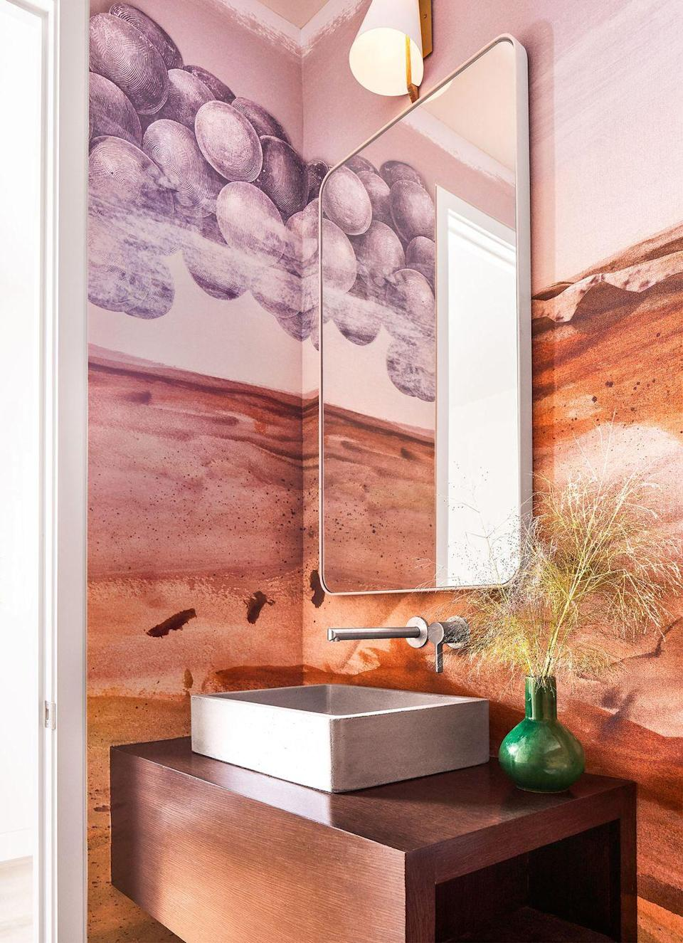 """<p>Our January/February 2021 issue gives us a brief history of <a href=""""https://www.elledecor.com/design-decorate/room-ideas/a35394007/powder-room-history-trends-2021/"""" rel=""""nofollow noopener"""" target=""""_blank"""" data-ylk=""""slk:powder rooms"""" class=""""link rapid-noclick-resp"""">powder rooms</a>—and why they might actually be the best room in the house. Here, the Dallas-based firm <a href=""""https://www.jeanliudesign.com/"""" rel=""""nofollow noopener"""" target=""""_blank"""" data-ylk=""""slk:Jean Liu Design"""" class=""""link rapid-noclick-resp"""">Jean Liu Design</a> created the powder room we all need, sheathed in a warm, uplands landscape wallpaper by Calico matched with a Nipomo sink by Native Trails. Principal Jean Liu takes a modern approach and turns to her travels and love of fashion when designing both residential and commercial spaces.</p>"""