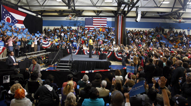 First lady Michelle Obama speaks as she campaigns for her husband, President Barack Obama, at a rally at Cuyahoga Community College Monday, Oct. 15, 2012, in Cleveland. (AP Photo/Tony Dejak)