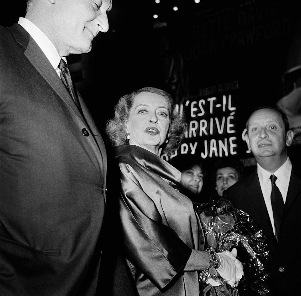 "<p>Bette Davis arrives at the Paris, France premiere of <em>Whatever Happened to Baby Jane? </em>on May 18, 1963. Production of the film was notoriously rocky between stars Bette Davis and Joan Crawford. Their infamous battle was later depicted in the 2017 miniseries <em>Feud: Bette and Joan</em>.</p><p><strong> Related: <a href=""https://www.redbookmag.com/life/g29903499/most-underrated-tv-shows-of-2010s/"" rel=""nofollow noopener"" target=""_blank"" data-ylk=""slk:The Most Underrated TV Shows of the Decade"" class=""link rapid-noclick-resp"">The Most Underrated TV Shows of the Decade</a></strong></p>"