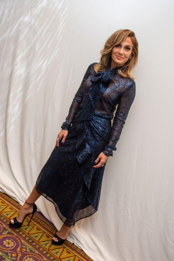 <p>To speak to the media to promote her new film, ahead of its premiere, Lopez looked sophisticated in a sheer midi blue dress with a pussy bow neckline. </p>