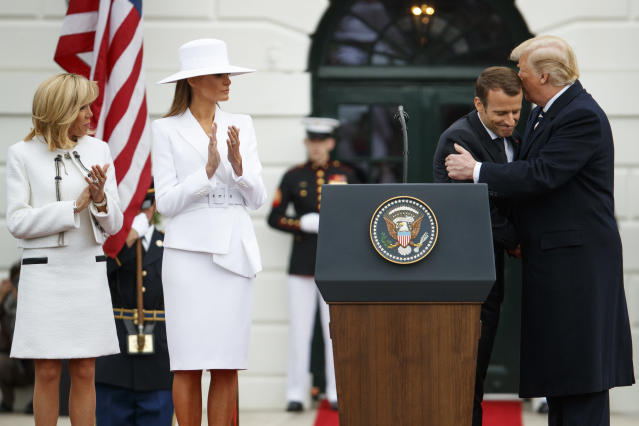 <p>Brigitte Macron and first lady Melania Trump look on as President Donald Trump hugs French President Emmanuel Macron during a State Arrival Ceremony on the South Lawn of the White House, Tuesday, April 24, 2018, in Washington. (Photo: Evan Vucci/AP) </p>