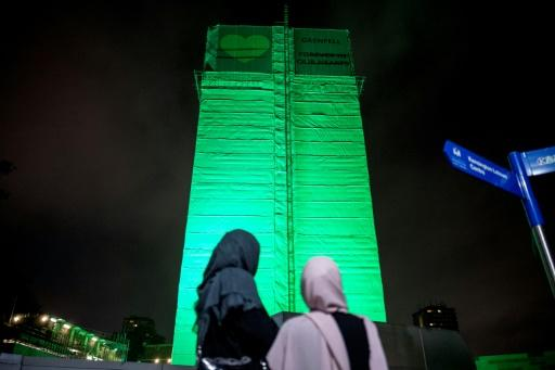 London's Grenfell Tower, where 71 people were killed in a fire a year ago, was illuminated in green