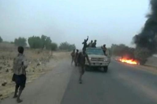 Dangerous roads: A screen grab from a January 2018 video released by Boko Haram, showing jihadists attacking the military on a highway near Maiduguri
