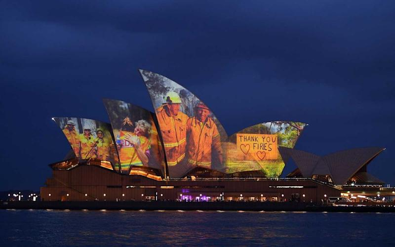 The sails of the Opera House are lit with a series of images to show support for the communities affected by the bushfires and to express the gratitude to the emergency services and volunteers in Sydney on January 11, 2020   SAEED KHAN/Getty Images