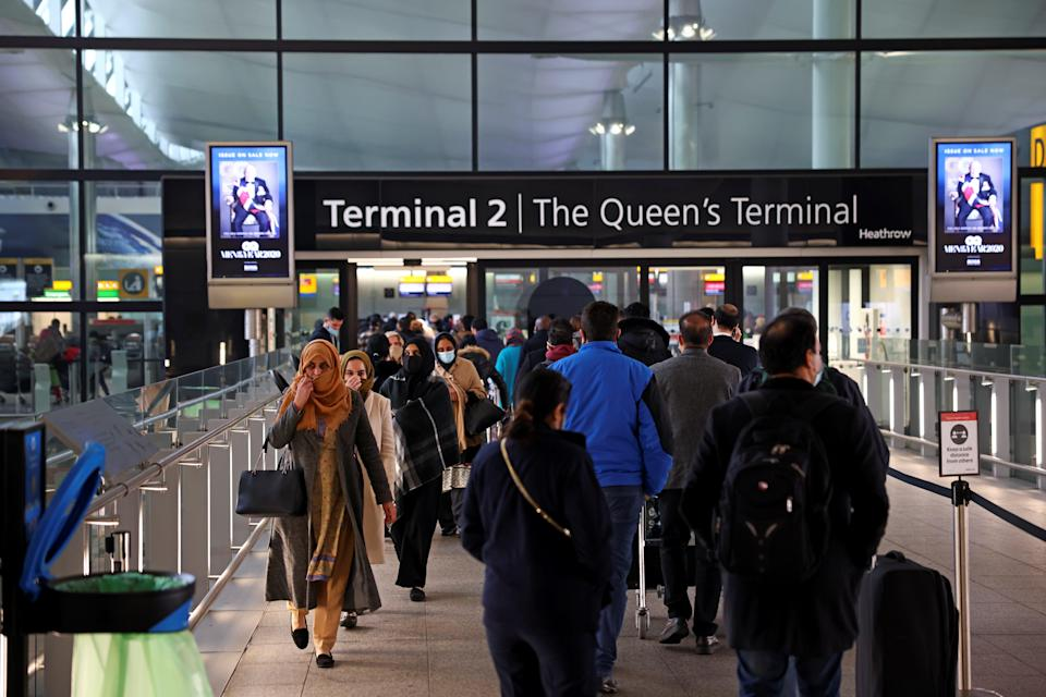 <p>People queue to enter Terminal 2 at Heathrow</p> (REUTERS)