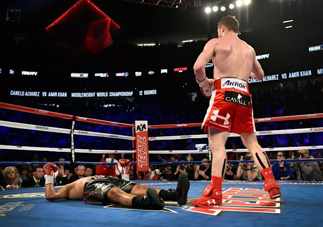 Canelo Alvarez stands over Amir Khan after delivering a knockout during the sixth round of their WBC middleweight title fight at T-Mobile Arena on May 7, 2016 in Las Vegas, Nevada. (Getty Images)