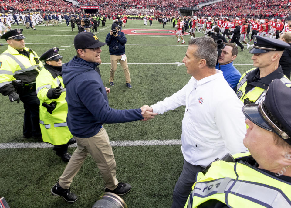 Ohio State Buckeyes head coach Urban Meyer and Michigan Wolverines head coach Jim Harbaugh shake hands after the game at Ohio Stadium on November 24, 2018. (Getty)