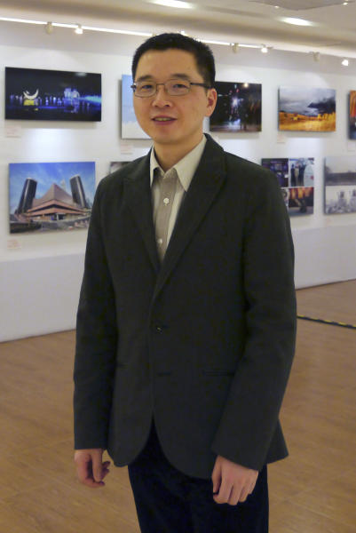 In this Sept. 2, 2012 photo released by Wu Qian, ex-wife of Chinese official Yu Qiyi on Monday, April 15, 2013, Yu Qiyi poses for a photo at an exhibition held at a hotel in Beijing. Yu had a promising career in a government investment company when he disappeared on his way home from a business trip March 1, 2013. Thirty-eight days later, the bespectacled, boyish-looking engineer died after turning up in a hospital emaciated, with bruises on his arms and thighs, dark welts on his buttocks and scrapes on his feet and shins. Images of his battered and bruised body have made him a rallying point for critics of the party's internal anti-corruption system that operates outside the law, allowing for abuses like the ones Yu's supporters allege he suffered. (AP Photo/Wu Qian) EDITORIAL USE ONLY