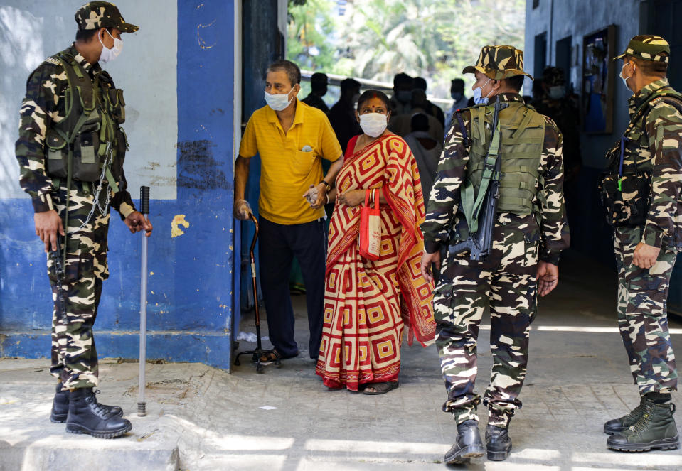 Voters leave a polling station after casting their votes during the fourth phase of West Bengal state elections in Kolkata, India, Saturday, April 10, 2021. (AP Photo/Bikas Das)