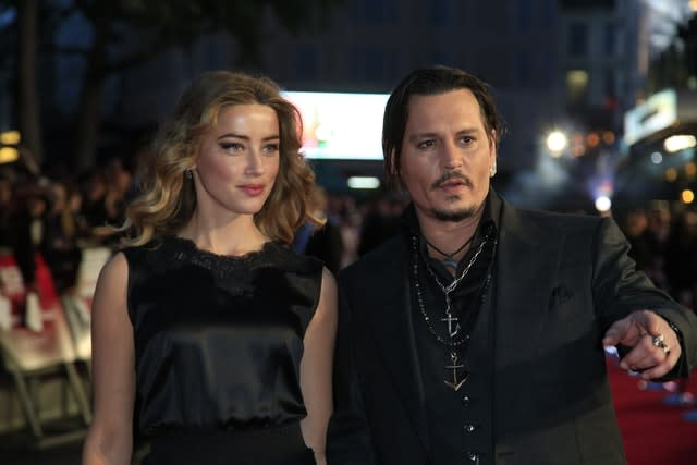 Amber Heard and Johnny Depp at a premiere (Jonathan Brady/PA)