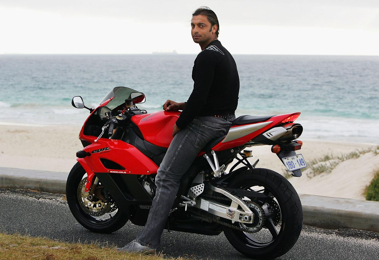 PERTH, AUSTRALIA - DECEMBER 15:  Pakistani cricketer Shoaib Akhtar poses on a motorbike during a photo shoot at City Beach December 15, 2004 in Perth, Australia. (Photo by Ryan Pierse/Getty Images)