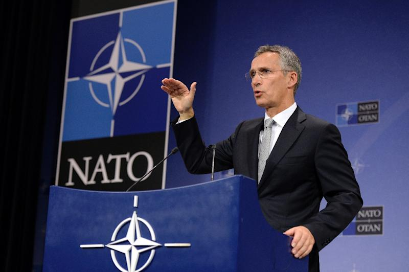 NATO Secretary General Jens Stoltenberg addresses a press conference at the NATO headquarters in Brussels, on October 6, 2015 (AFP Photo/Thierry Charlier)