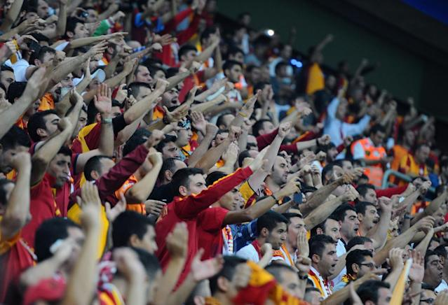Galatasaray's supporters chant before their Champions League Group B soccer match with Real Madrid in Istanbul, Turkey, Tuesday, Sept. 17, 2013. (AP Photo)