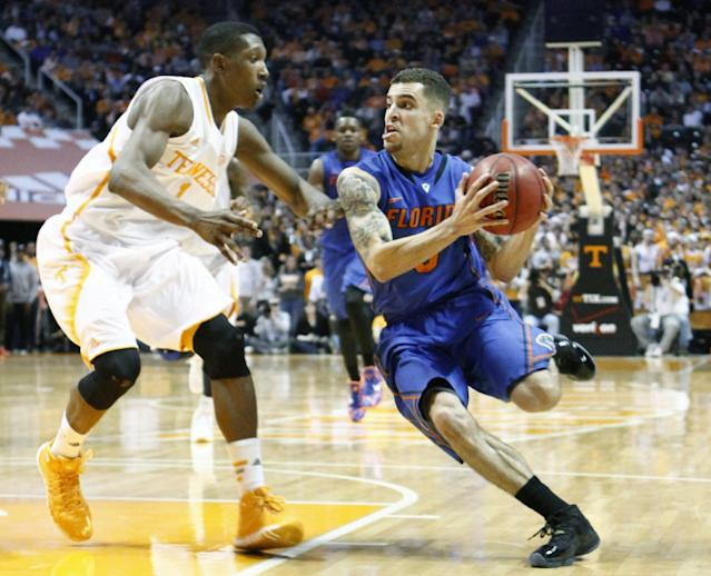 Florida guard Scottie Wilbekin, right, drives against Tennessee guard Josh Richardson, left, in the second half of an NCAA college basketball game, Tuesday, Feb. 11, 2014, in Knoxville, Tenn. Florida won 67-58. (AP Photo/Wade Payne)