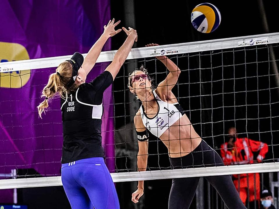 Canada's Sarah Pavan, right, and Melissa Humana-Paredes had to settle for a beach volleyball silver medal at the World Tour Finals after being swept 21-13, 23-21 by Germany's Julia Sude, left, and Karla Borger in Sunday's gold-medal game in Cagliari, Italy. (Submitted by FIVB - image credit)