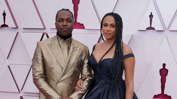 PHOTO: Leslie Odom Jr. and Nicolette Robinson arrive at the Oscars, April 25, 2021, at Union Station in Los Angeles.  (Chris Pizzello/Pool/AFP via Getty Images)