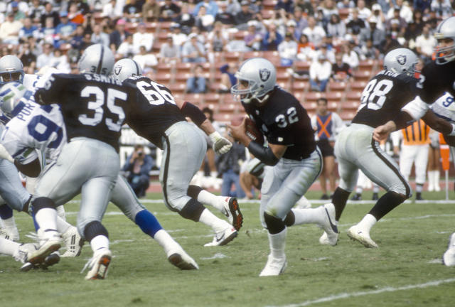 Tough to beat the simplicity worn by Marcus Allen and the Raiders here. (Photo by Focus on Sport/Getty Images)
