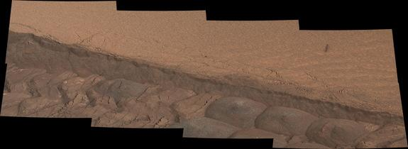 A wheel track deliberately cuts through a windblown ripple of dusty sand in this composite image taken by NASA's Curiosity Mars rover on Nov. 7, 2014.