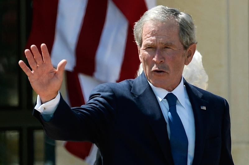 Former President George W. Bush waves goodbye on April 25, 2013 in Dallas, Texas