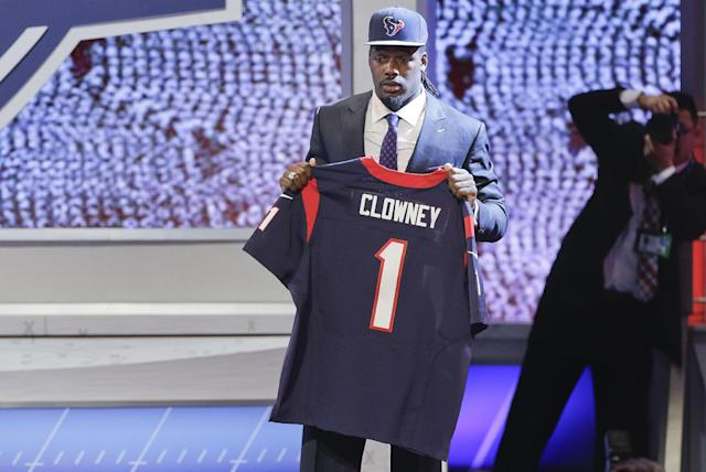 South Carolina defensive end Jadeveon Clowney holds up a jersey for the Houston Texans after being chosen as the first pick in the first round of the 2014 NFL Draft, Thursday, May 8, 2014, in New York. (AP Photo/Frank Franklin II)