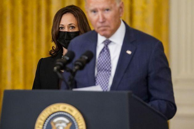 WASHINGTON, DC - AUGUST 20: Vice President Kamala Harris looks on as President Joe Biden, flanked by Secretary of Defense Lloyd Austin, Secretary of State Antony Blinken and White House National Security Advisor Jake Sullivan, takes a question from a reporter after delivering remarks on the evacuation of American citizens and their families, SIV applicants and their families, and vulnerable Afghans from Afghanistan, in the East Room of the White House complex on Friday, Aug. 20, 2021 in Washington, DC. (Kent Nishimura / Los Angeles Times via Getty Images) (Photo: Kent Nishimura via Getty Images)