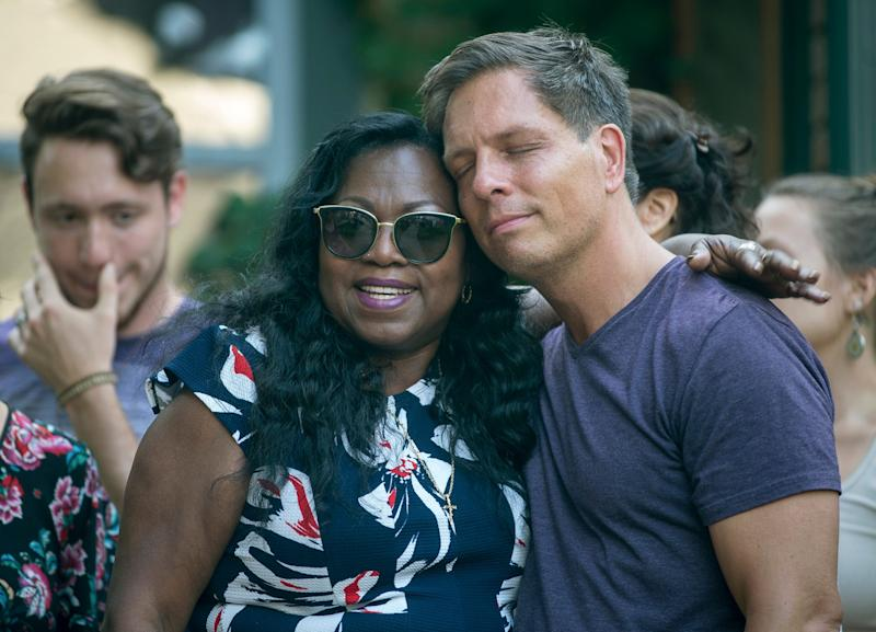 Don Damond, the fiance of Justine Damond, is comforted outside his home by Valerie Castile, the mother of Philando Castile - Credit: Aaron Lavinsky/AP