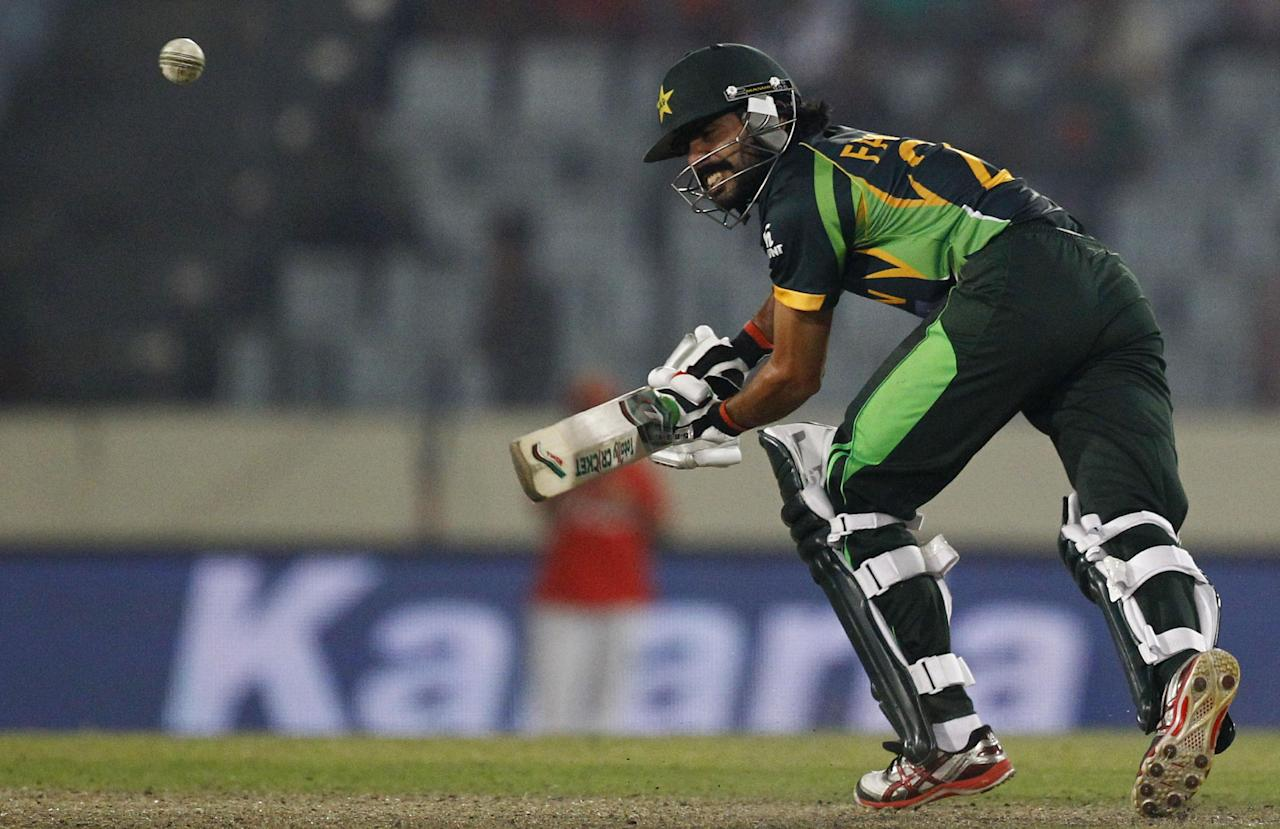 Pakistan's Fawad Alam , plays a shot during their match against Bangladesh in the Asia Cup one-day international cricket tournament in Dhaka, Bangladesh, Tuesday, March 4, 2014. (AP Photo/A.M. Ahad)
