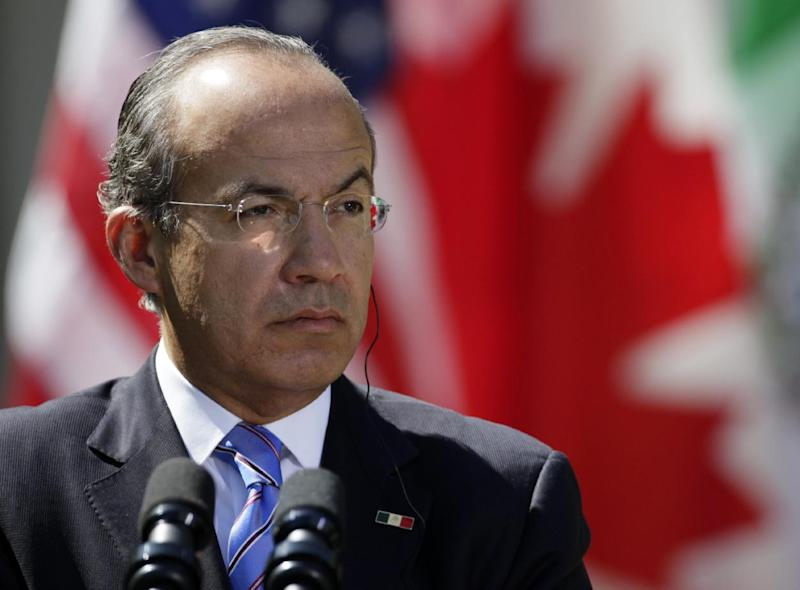 FILE - In this April 2, 2012 file photo, Mexican President Felipe Calderon participates in a joint news conference with President Barack Obama and Canadian Prime Minister Stephen Harper,  in the Rose Garden at the White House in Washington. The government said Thursday that 68,000 guns recovered by Mexican authorities in the past five years have been traced back to the United States. (AP Photo/Carolyn Kaster, File)