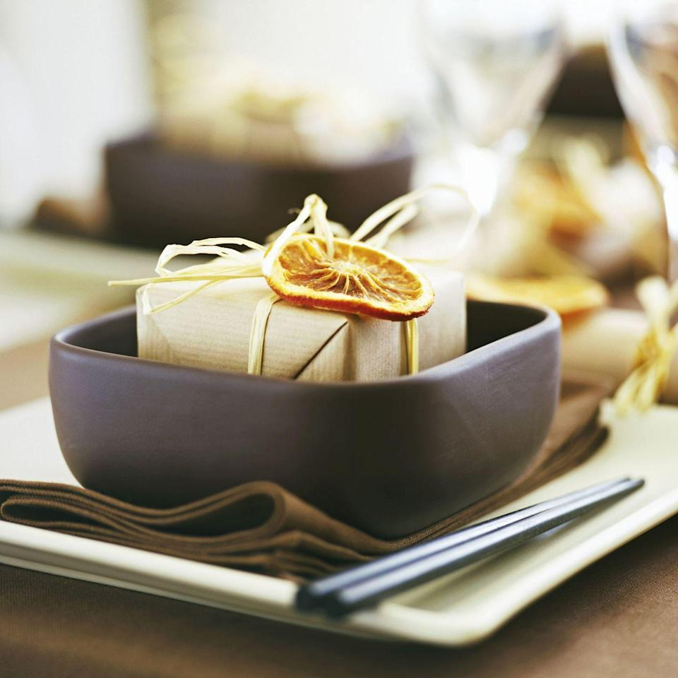 <p>Everyone appreciates a thoughtful dinner party favor. Start your holiday party off in style by topping your token of appreciation off with a dried orange slice.</p>