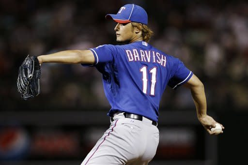 Texas Rangers starting pitcher Yu Darvish throws to the Colorado Rockies during the fourth inning of a spring training baseball game, Friday, March 30, 2012, in Scottsdale, Ariz. (AP Photo/Marcio Jose Sanchez)