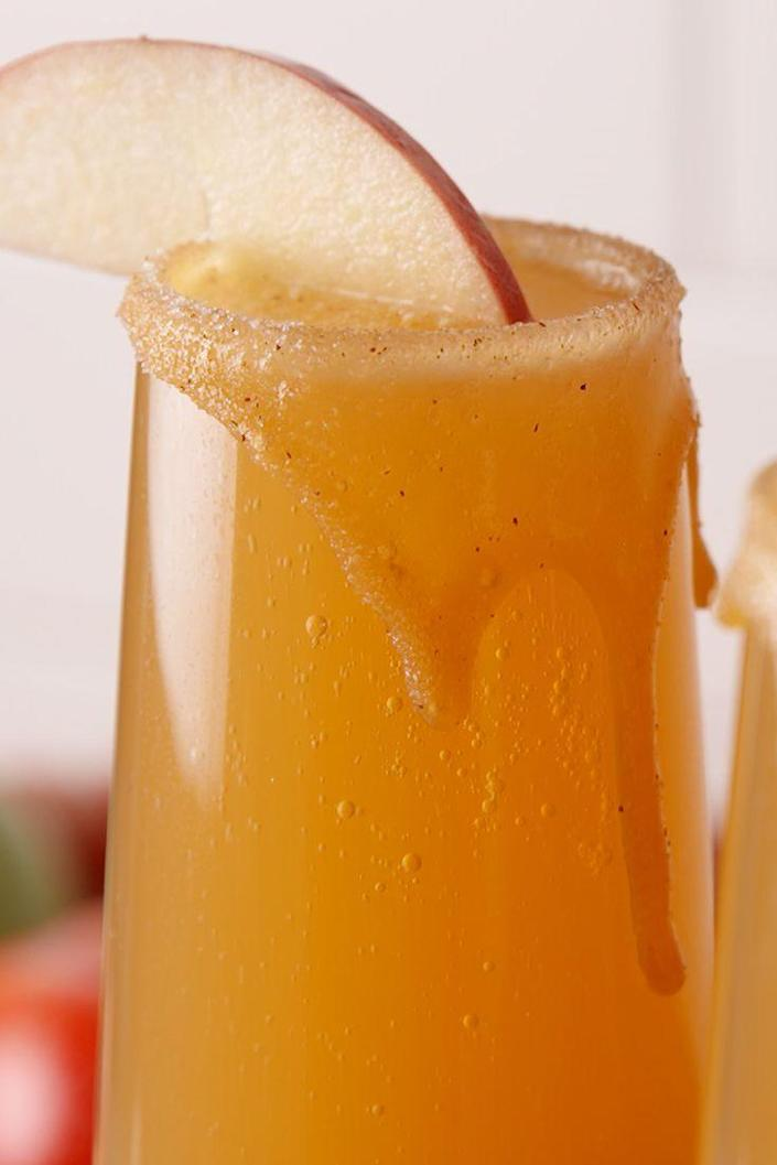 """<p>Booze + no gooey mess? This is the best caramel apple we've ever had.</p><p>Get the recipe from <a href=""""https://www.delish.com/cooking/recipe-ideas/recipes/a49432/caramel-apple-mimosas-recipe/"""" rel=""""nofollow noopener"""" target=""""_blank"""" data-ylk=""""slk:Delish"""" class=""""link rapid-noclick-resp"""">Delish</a>.</p>"""