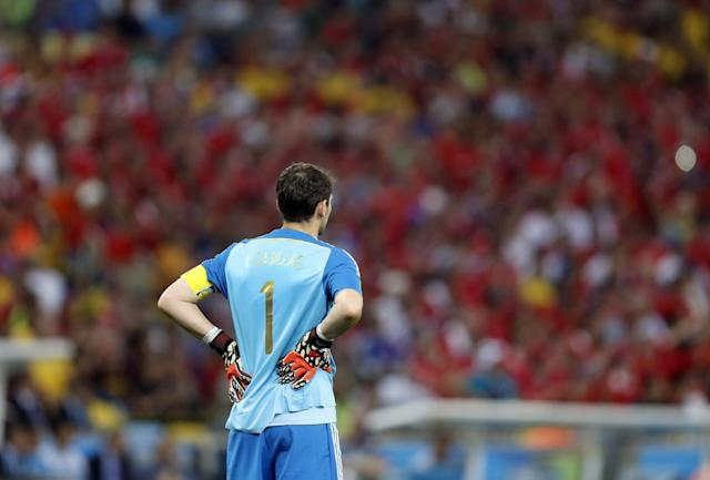 Spain's goalkeeper Iker Casillas stands near his goal mouth in the final minutes of the group B World Cup soccer match between Spain and Chile at the Maracana Stadium in Rio de Janeiro, Brazil, Wednesday, June 18, 2014. Defending champion Spain was eliminated from the World Cup after losing to Chile 2-0. (AP Photo/Frank Augstein)