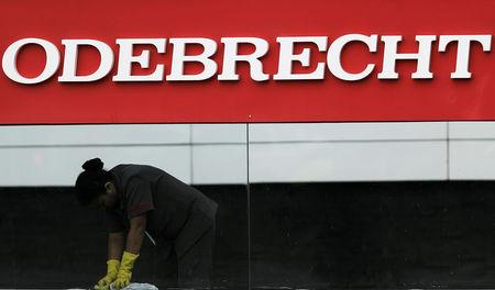 A worker cleans the corporate logo of the Odebrecht SA construction conglomerate at its headquarters in Sao Paulo, Brazil, April 17, 2017. REUTERS/Nacho Doce