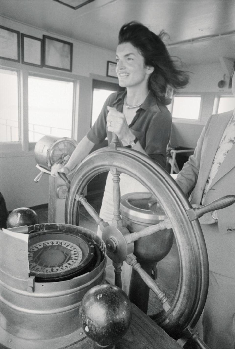 <p>Jacqueline Kennedy Onassis behind the wheel of the Staten Island Ferry on its voyage back to Manhattan in 1976. </p>