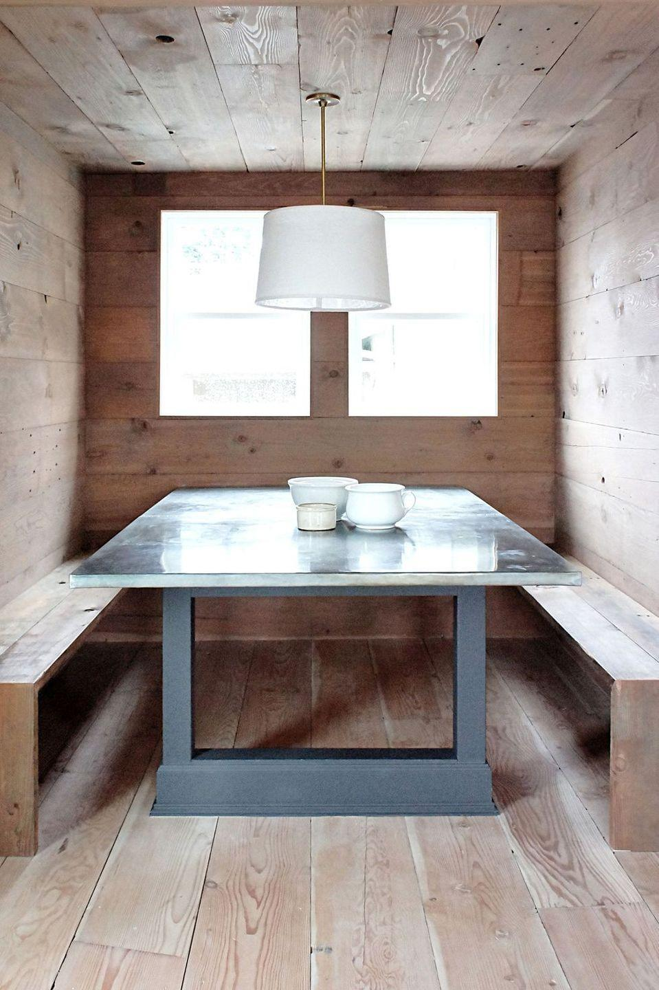 """<p>The only thing cozier than a breakfast nook is an enclosed breakfast nook. Designed by <a href=""""https://kaemingkdesign.com/"""" rel=""""nofollow noopener"""" target=""""_blank"""" data-ylk=""""slk:Kaemingk Design"""" class=""""link rapid-noclick-resp"""">Kaemingk Design</a>, this one is a masterclass in pared-down Scandinavian style. The warm wood materials and enclosed setting make it feel inviting and intimate and you can always swap out different cushions as the seasons change. </p>"""