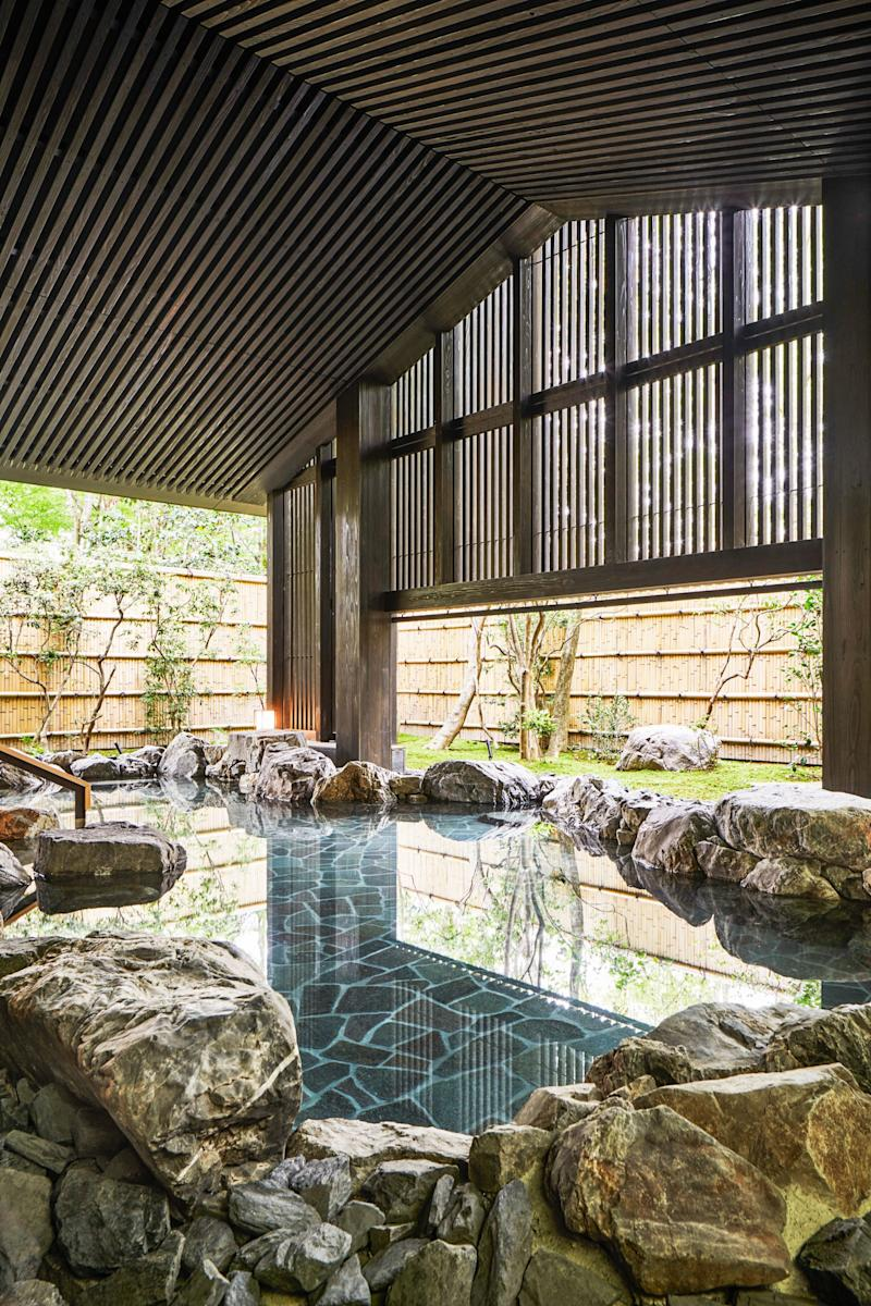 An outdoor bath at the hotel's onsen spa.