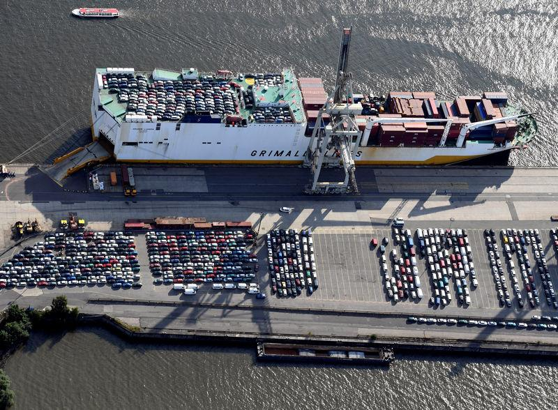 FILE PHOTO: Export cars are loaded on a RoRo ship of Italian Grimaldi Group at a terminal in the port of Hamburg