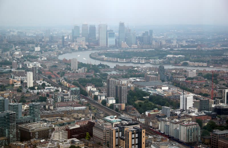 FILE PHOTO: The Canary Wharf financial district is seen from the construction site of 22 Bishopsgate in London