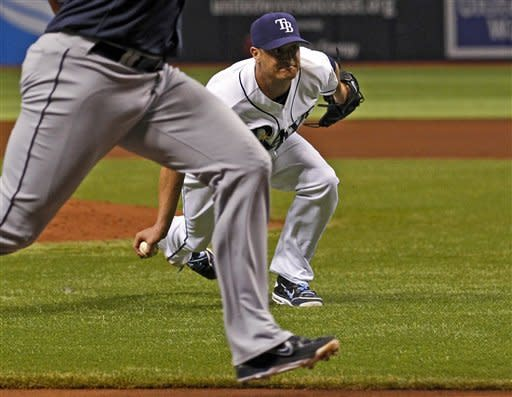Tampa Bay Rays starting pitcher Alex Cobb fields a ball that lined off of his leg to throw out Seattle Mariners' Carlos Peguero at home during the second inning of a baseball game Saturday, July 21, 2012, in St. Petersburg, Fla. Cobb left with an injury following the play. (AP Photo/Mike Carlson)