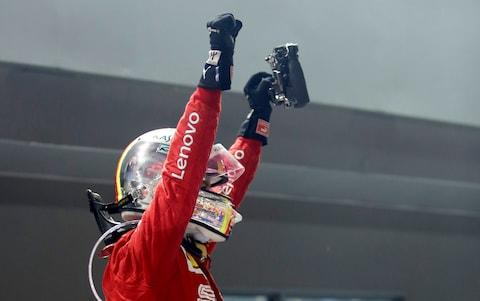 <span>Vettel celebrates his win</span> <span>Credit: REUTERS </span>