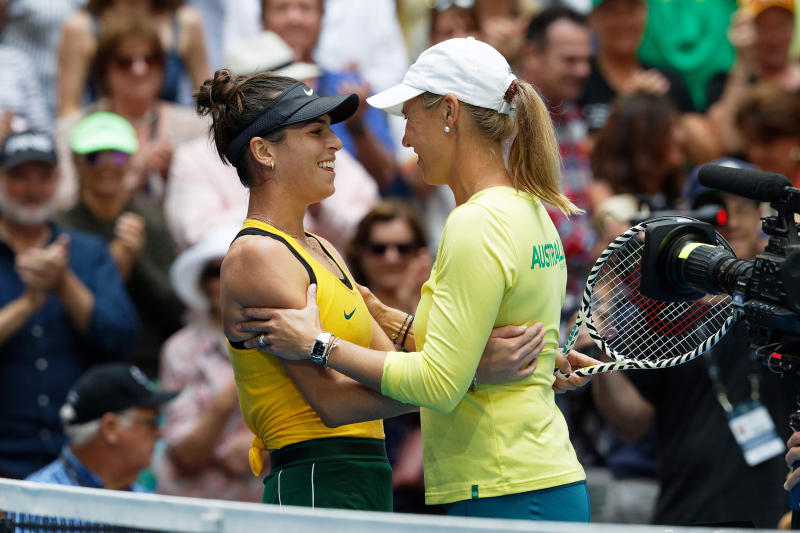 Australia's Ajla Tomljanovic, left, is hugged by Australian captain Alicia Molik after winning her match against France's Pauline Parmentier during their Fed Cup tennis final in Perth, Australia, Sunday, Nov. 10, 2019. (AP Photo/Trevor Collens)