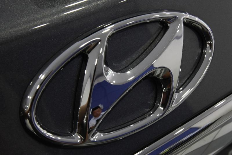 The logo of Hyundai Motor is seen on a car displayed at a Hyundai dealership in Seoul