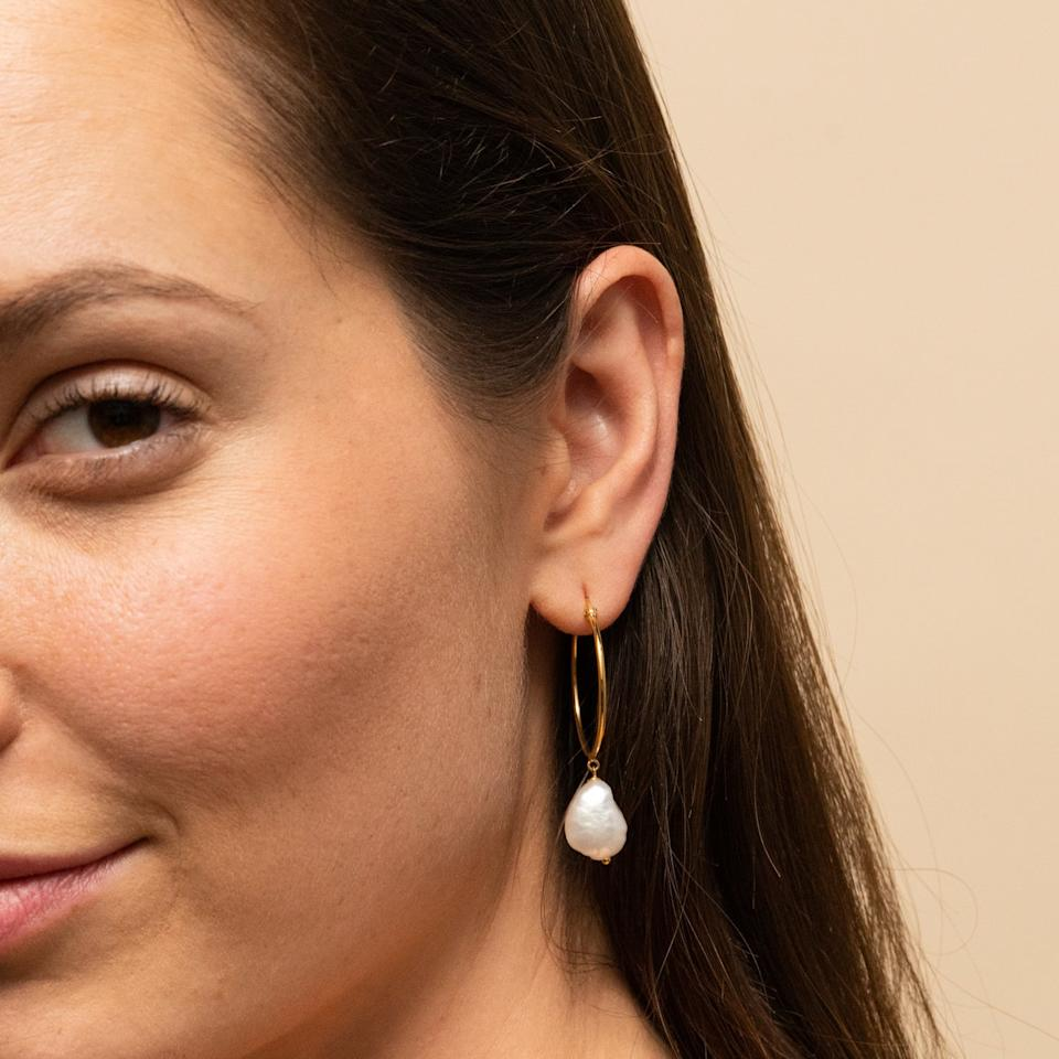 """<p>These <a href=""""https://www.popsugar.com/buy/Mejuri-Organic-Pearl-Large-Hoops-445266?p_name=Mejuri%20Organic%20Pearl%20Large%20Hoops&retailer=mejuri.com&pid=445266&price=75&evar1=fab%3Aus&evar9=34784732&evar98=https%3A%2F%2Fwww.popsugar.com%2Ffashion%2Fphoto-gallery%2F34784732%2Fimage%2F47545695%2FMejuri-Organic-Pearl-Large-Hoops&list1=shopping%2Cjewelry%2Caccessories%2Cfashion%20trends%2Cpearls&prop13=mobile&pdata=1"""" rel=""""nofollow"""" data-shoppable-link=""""1"""" target=""""_blank"""" class=""""ga-track"""" data-ga-category=""""Related"""" data-ga-label=""""https://mejuri.com/shop/products/organic-pearl-large-hoops"""" data-ga-action=""""In-Line Links"""">Mejuri Organic Pearl Large Hoops</a> ($75) are classic and gorgeous.</p>"""