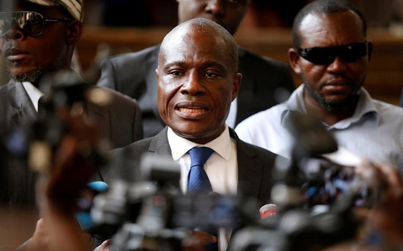 Martin Fayulu, Congolese joint opposition presidential candidate, talks to members of the press as he leaves a meeting regarding the code of good conduct ahead of December 30 elections in Kinshasa - REUTERS