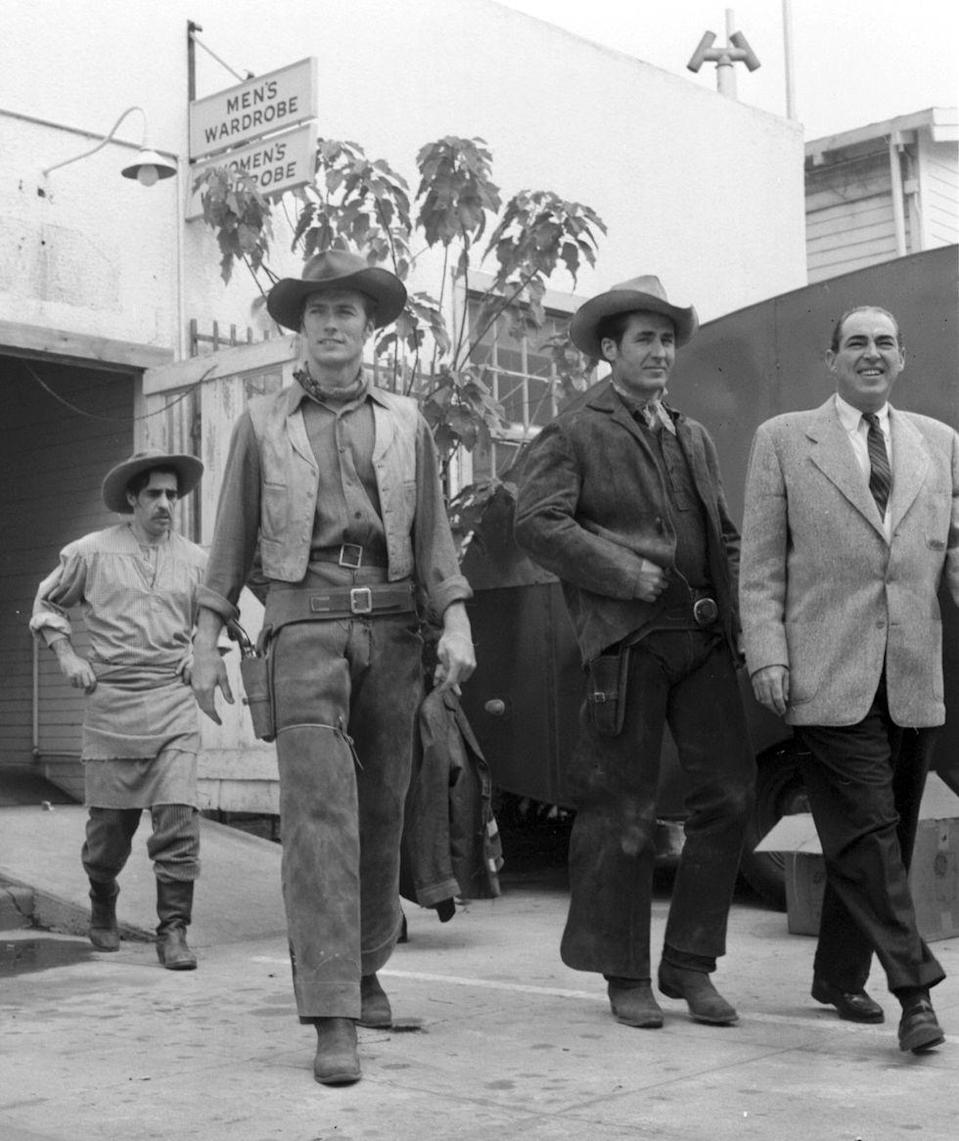 <p>The actor caught his big break in 1959, when CBS cast him in their new western television series, <em>Rawhide</em>. Here, Eastwood leaves wardrobe on the CBS lot. </p>