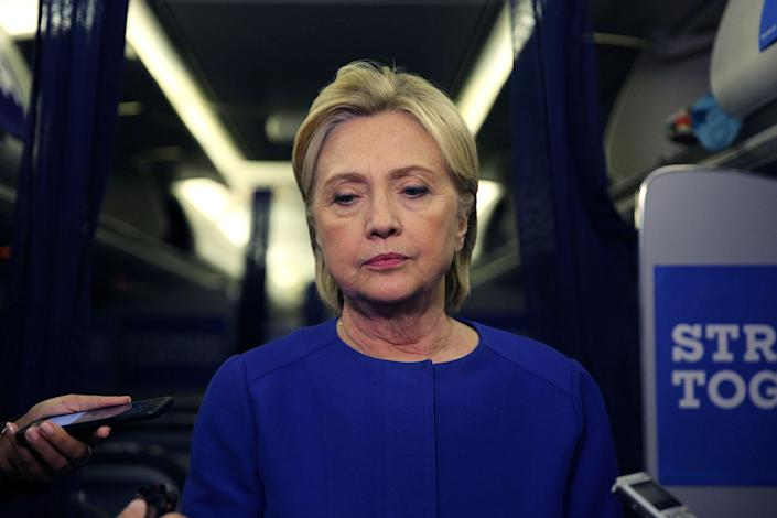 <p>Hillary Clinton talks to reporters about the explosion in Chelsea neighborhood of Manhattan, New York, as she arrives to at the Westchester County airport in White Plains, U.S., September 17, 2016. (Carlos Barria/Reuters) </p>