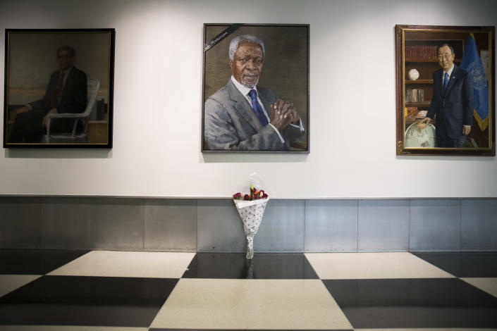 A black ribbon and a bouquet of flowers adorn the portrait of former United Nations Secretary-General Kofi Annan at U.N. headquarters, Saturday, Aug. 18, 2018. Annan, one of the world's most celebrated diplomats and a charismatic symbol of the United Nations who rose through its ranks to become the first black African secretary-general, has died. He was 80. (AP Photo/Mary Altaffer)